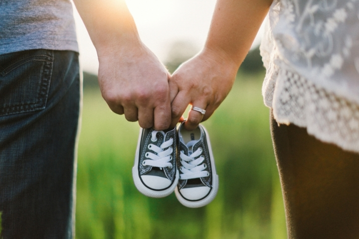 Couple-with-Baby-Shoes